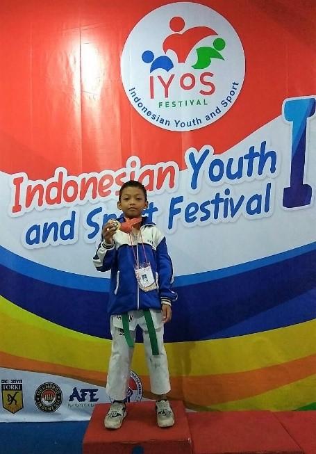 Hasan Raih Medali Emas Taekwondo di Kejurnas IYoS 2016